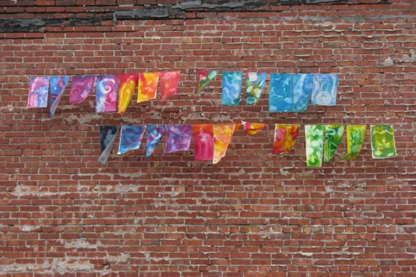 flags on brick wall