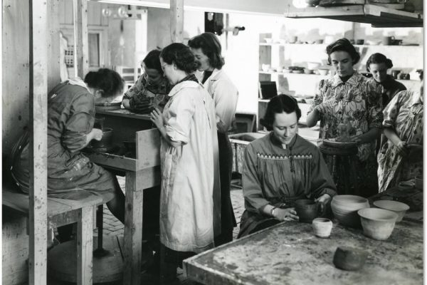 Applied Arts Students learning the kick wheel for the first time in the basement of the Owens back in 1937