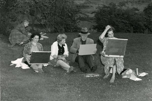Summer Art Workshop instructor Charles Fraser Comfort and his students in 1958 on the lawn in front of the Owens. Mount Allison University Archives Picture Collection 2007.07:568