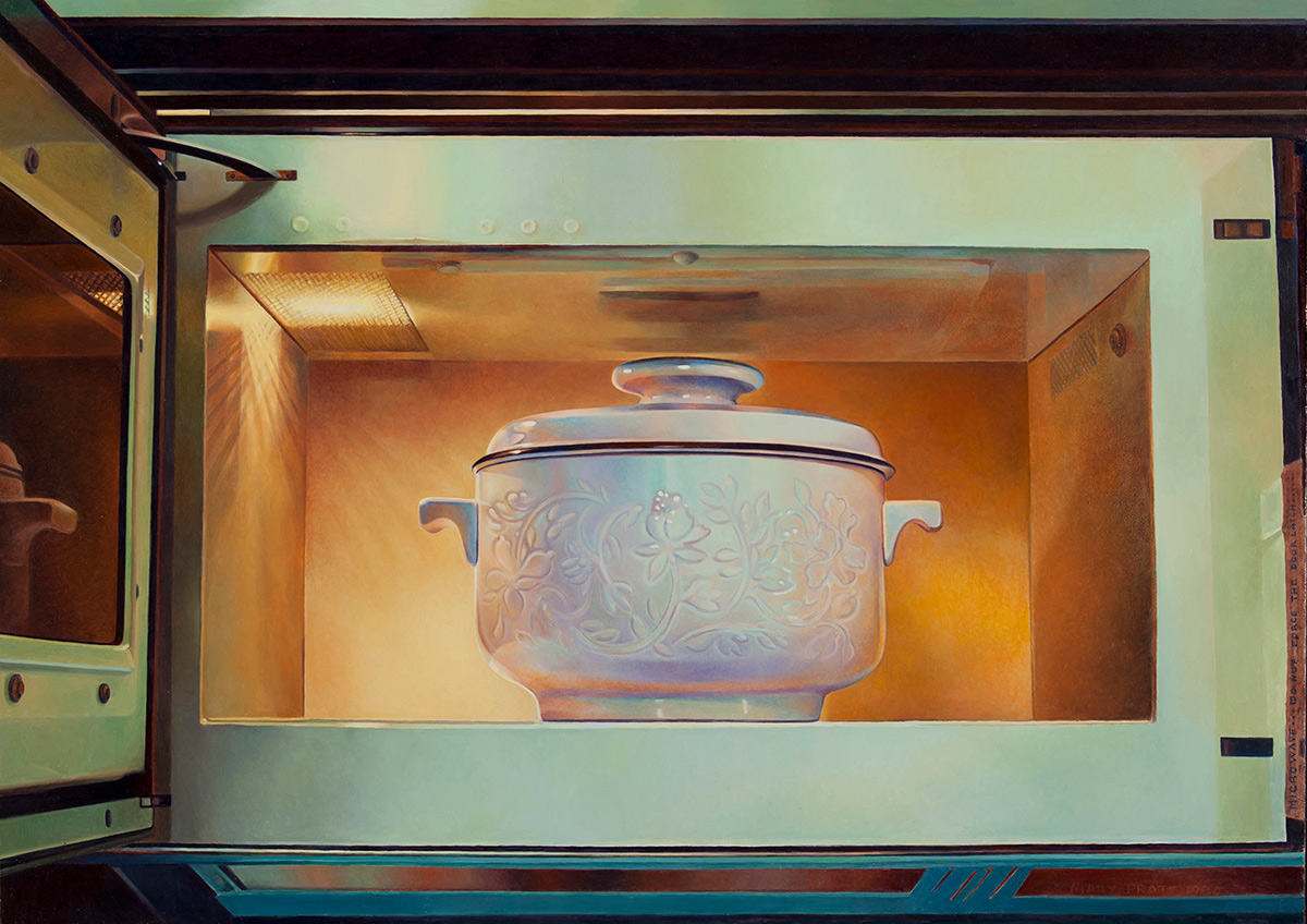 A white casserole dish decorated with an embossed floral design sits inside an open microwave oven. The interior of the microwave is illuminated with a yellow and orange glow that radiates from the oven's light in the upper left.