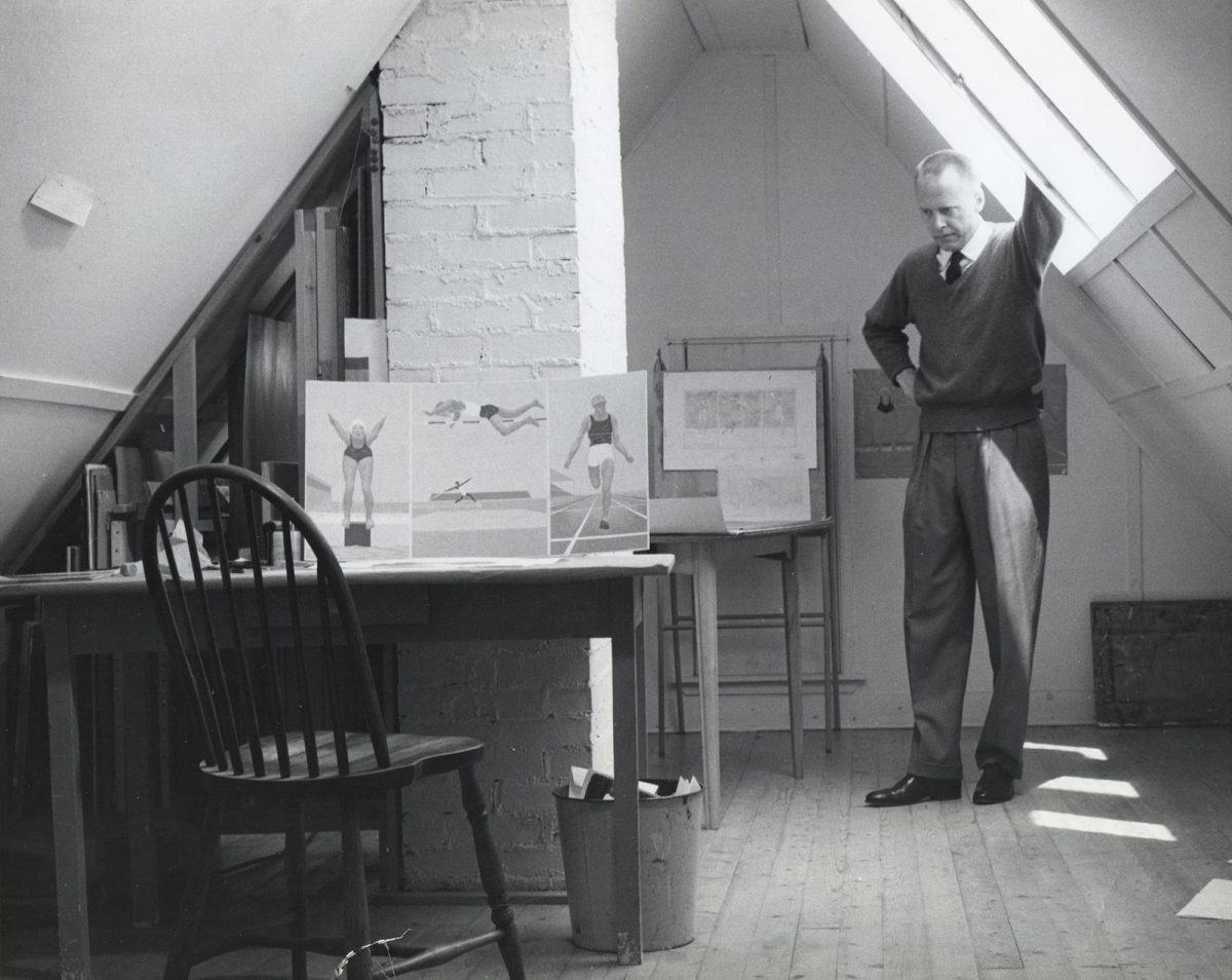 In an attic with steep ceilings, Alex Colville looks down pensively at his desk while resting his arm against one of the large sky lights. Propped up on the table is a sketch of a tryptic of a swimmer, high jumper and runner. Behind him, on an easel is another sketch with the same subject matter.