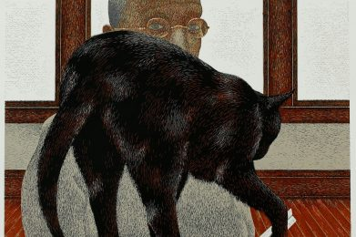 A black cat plays with a white triangular ruler using its right front paw, blocking a light- skinned man wearing gold-rimmed glasses. He is in a sitting position and is looking directly at the viewer.