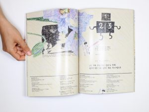 A hand holds open a book. On the pages, a drawing of a pressed orchid covers text and diagrams.